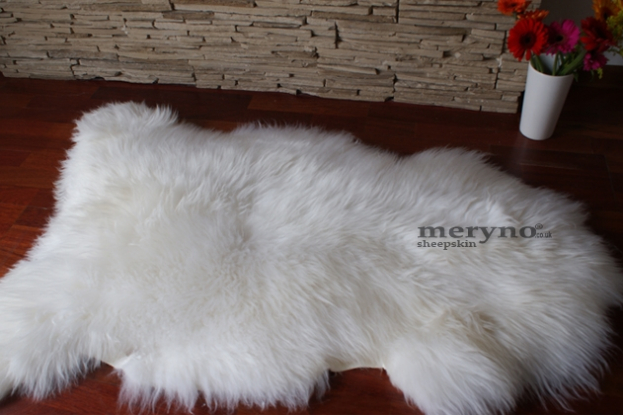 Genuine fluffy white sheepskin rug
